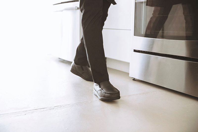 Person in kitchen wearing SAS Men's Navigator shoes