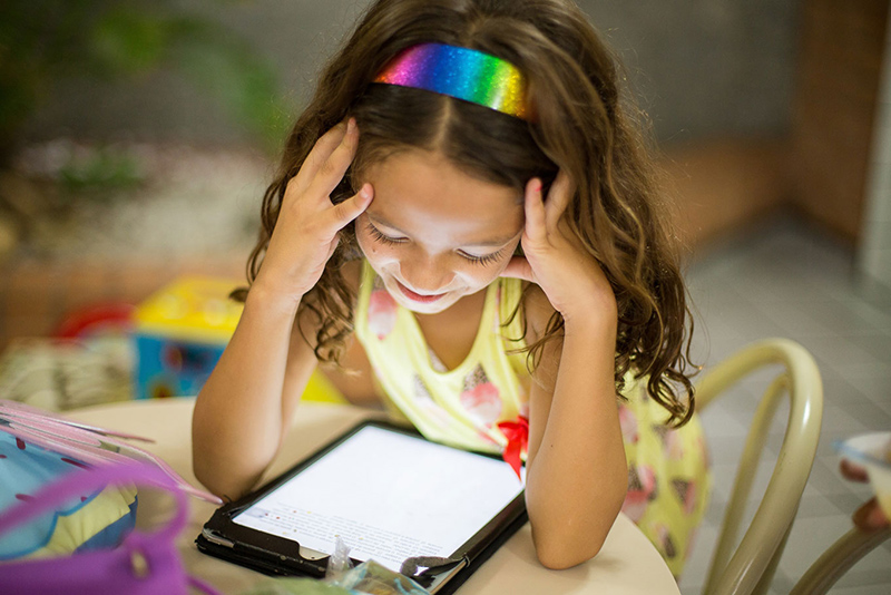 A girl on iPad browsing content